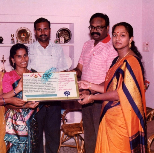 The President of SHAPE recives an Honorary Certificate from the then District Collector