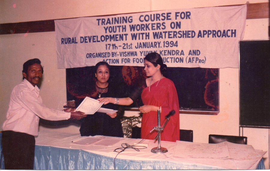 Founder getting certificate after attending watershed management training