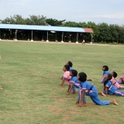 HIV Sponsorship children practicing yoga with a volunteer